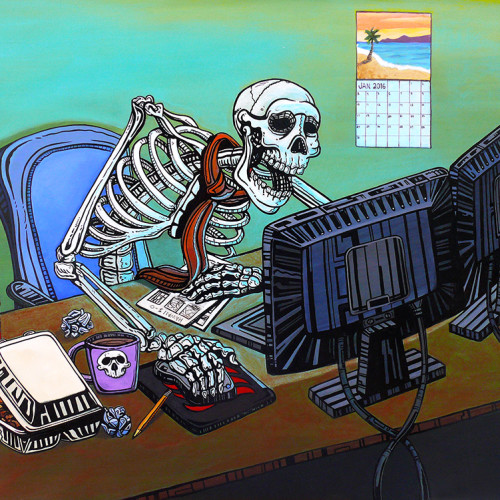 skeleton at a computer