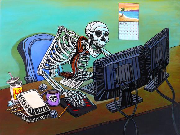 skeleton at a computer